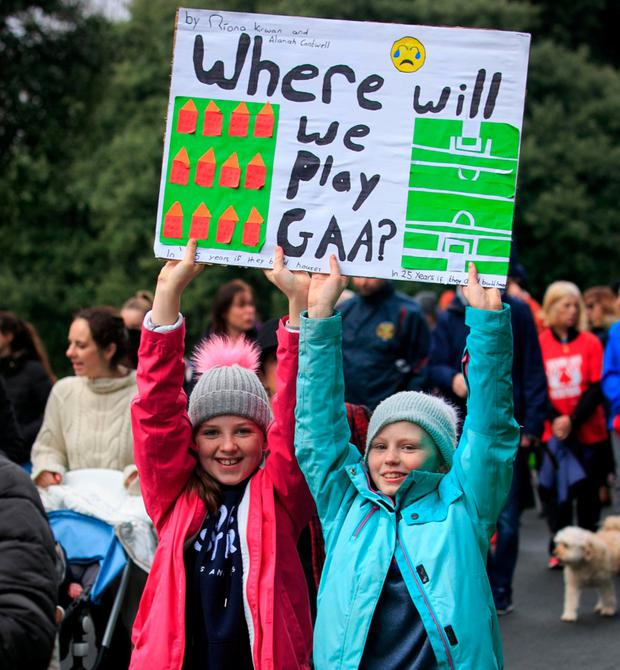Alana Cantwell and Riona Kirwan, from Clontarf, during a march protesting the proposed housing development near St Anne's Park. Photo: Collins
