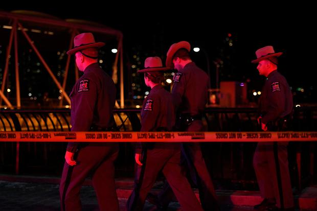 New York State Police are seen near East 34th Street/Midtown East Landing after a chartered Liberty Helicopters helicopter crashed into the East River in New York, U.S., March 11, 2018. REUTERS/Darren Ornitz