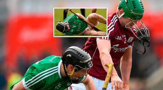 Barry Murphy of Limerick and Adrian Touhy of Galway tussle off the ball