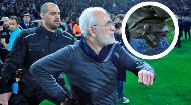 Russian-born Greek businessman and owner of PAOK Salonika, Ivan Savvides (C), pictured with what appears to be a gun in a holster