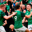 Jacob Stockdale of Ireland celebrates with Conor Murray, 9, and Dan Leavy, 7
