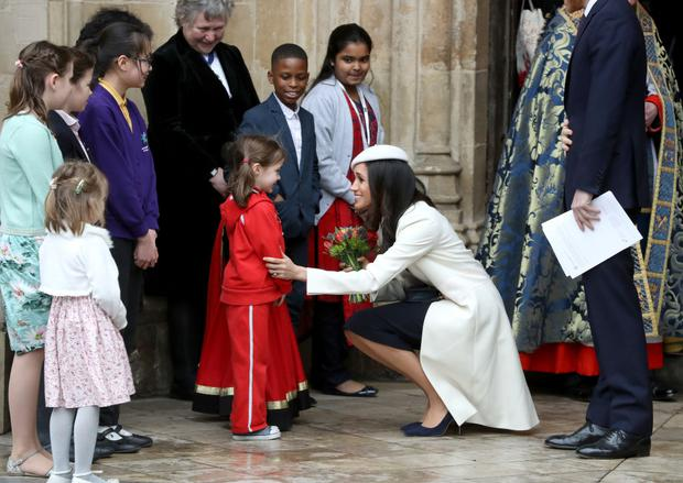 LONDON, ENGLAND - MARCH 12: Meghan Markle greets a child as she departs from the 2018 Commonwealth Day service at Westminster Abbey on March 12, 2018 in London, England. (Photo by Chris Jackson/Chris Jackson/Getty Images)