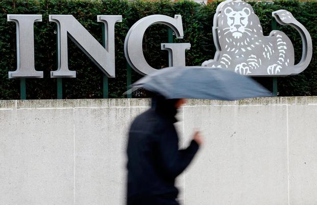 A pedestrian walks past the logo of ING bank by the group's main office in Brussels. Photo: Reuters