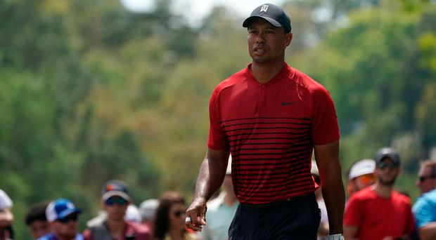 Tiger Woods walks off the 2nd tee during the final round of the Valspar Championship golf tournament at Innisbrook Resort, Copperhead Course. Photo: Jasen Vinlove-USA TODAY Sports