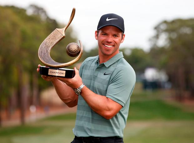 Paul Casey holds up the champion's trophy after winning the Valspar Championship golf tournament in Palm Harbor, Fla. (AP Photo/Mike Carlson)