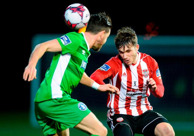 Derry City's Jack Doyle heads the ball clear. Photo: Oliver McVeigh/Sportsfile