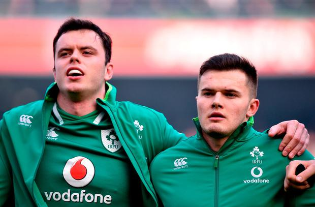 James Ryan, left, and Jacob Stockdale stand for the anthems before the Six Nations clash against Wales. Photo: David Fitzgerald/Sportsfile