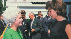 Princess Grace of Monaco wearing a Givenchy suit when she met Jackie Kennedy at the White House in May 1961