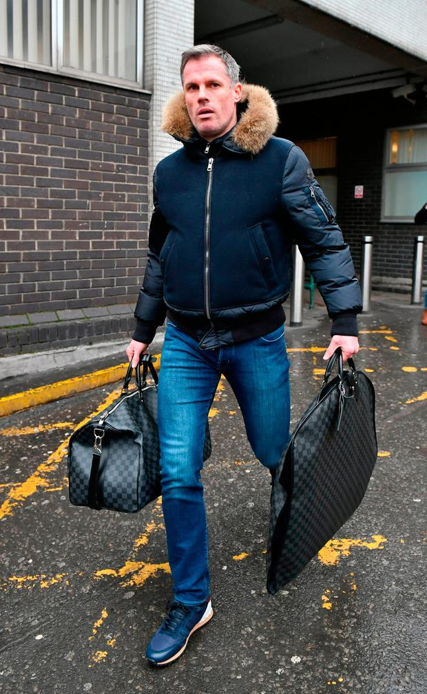 Jamie Carragher arrives in London for a showdown with Sky Sports bosses yesterday