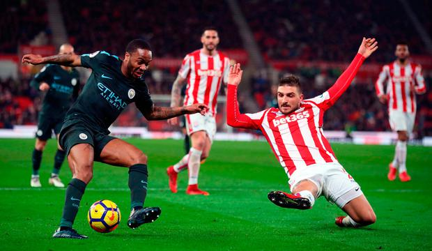 Raheem Sterling (left) turns inside a challenge from Stoke City's Kostas Stafylidis. Photo: PA