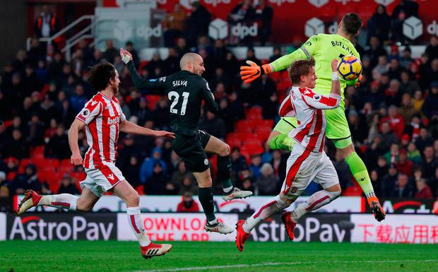 David Silva knocks the ball past Jack Butland for Manchester City's second goal. Photo: REUTERS