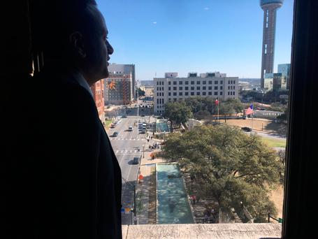 Leo Varadkar looks out of the seventh floor window of the Dallas County Administration Building close to the assassin's post for the shooting of John F. Kennedy in 1963