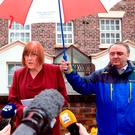 Lady Anne gives a statement outside her Liverpool home following the death of her husband Sir Ken Dodd who has died aged 90, as his nephew John Lewis looks on. Photo: PA