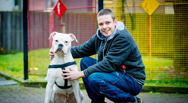 Andre Perrott (26) filmed playing outside with his dog Buster on Sunday