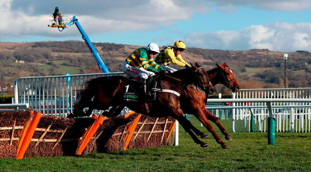 Buveur D'Air ridden by Barry Geraghty (front) on their way to winning the Unibet Champion Hurdle at the Cheltenham Festival during Champion Day of the 2018 Cheltenham Festival at Cheltenham Racecourse