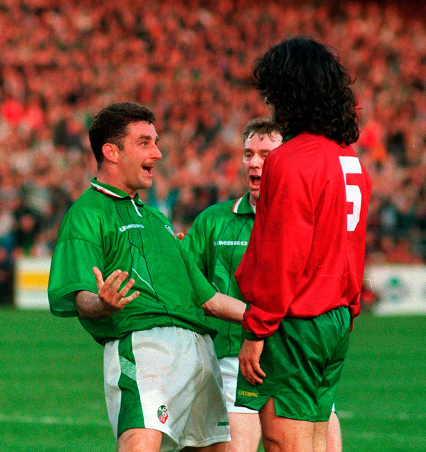 Ireland's John Aldridge celebrates his goal in the face of Portugal's Fernando Couto back in 95