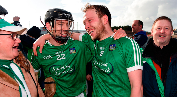 Graeme Mulcahy and Paul Browne of Limerick celebrate after beating Galway