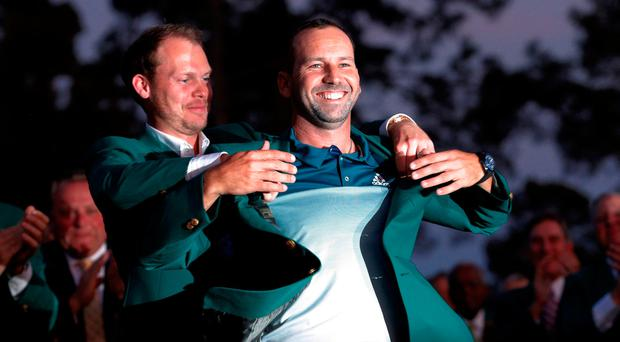 Sergio Garcia of Spain smiles as he is presented the green jacket last year