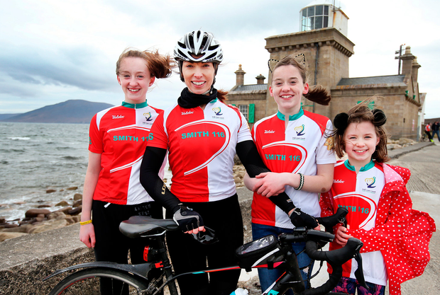 Martina Smith, wife of tragic Rescue 116 winchman Ciarán Smith, with their children Caitlín (12), Shannon (11) and Finlay (8) at Blacksod Lighthouse after completing a cycle from Dublin to Mayo in memory of her husband and the other crew members. Photo: Steve Humphreys