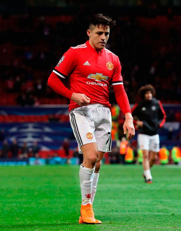 Manchester United's Alexis Sanchez looks dejected