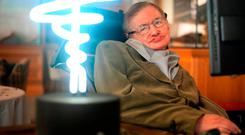 File photo dated 25/02/12 of Professor Stephen Hawking, who has died aged 76, posing beside a lamp titled 'black hole light' by inventor Mark Champkins, presented to him during his visit to the Science Museum in London. Anthony Devlin/PA Wire