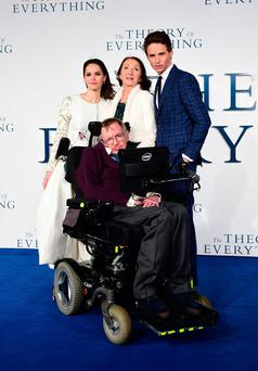 File photo dated 9/12/2014 of Professor Stephen Hawking (front), who has died aged 76, with (from left) Felicity Jones, Jane Hawking and Eddie Redmayne, attending the UK Premiere of The Theory of Everything at the Odeon Leicester Square, London. Ian West/PA Wire
