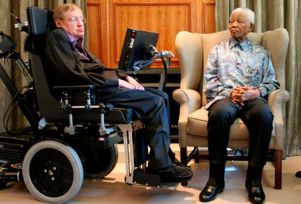 Former South African President Nelson Mandela (R) meets theoretical physicist professor Stephen Hawking at Mandela's Foundation office in Johannesburg May 15, 2008. Pool/via REUTERS/File photo