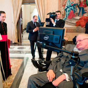 FILE - In this Monday, Nov. 28, 2016 file photo Pope Francis greets physicist Stephen Hawking during an audience with participants at a plenary session of the Pontifical Academy of Sciences, at the Vatican. (L'Osservatore Romano/pool photo via AP, File)