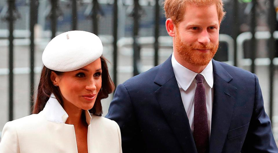 Britain's Prince Harry (R) and his fiancee US actress Meghan Markle attend a Commonwealth Day Service at Westminster Abbey in central London, on March 12, 2018