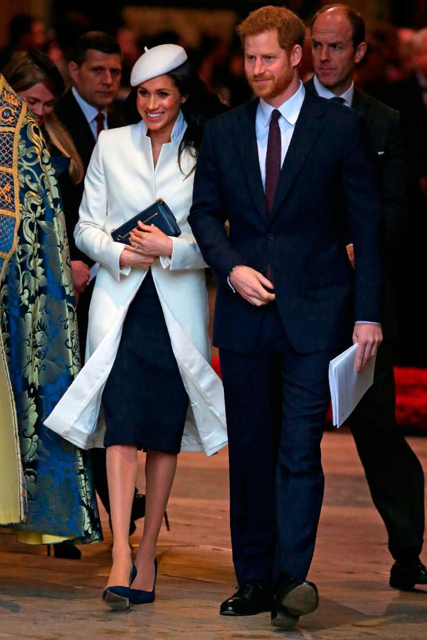 Britain's Prince Harry (R) leaves with his fiancee, US actress Meghan Markle after attending a Commonwealth Day Service at Westminster Abbey in central London, on March 12, 2018 LEAL-OLIVAS/AFP/Getty Images