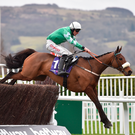 Presenting Percy, with Davy Russell up clears the last on their way to winning The RSA Steeple Chase on Day Two of the Cheltenham Racing Festival last year