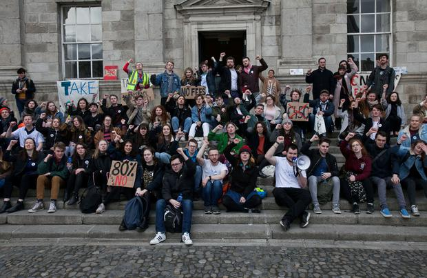 Students in Trinity College Dublin protesting over the implementation of Supplemental Fees at a flat rate of €450 outside the Dining Hall on Tuesday. Photo Gareth Chaney Collins