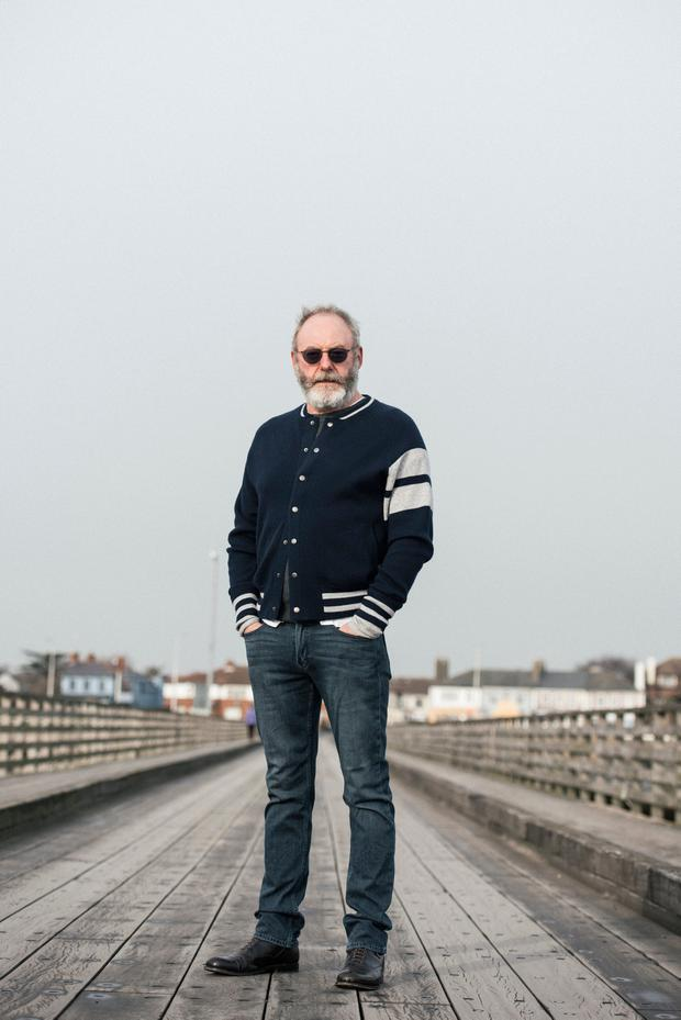Actor Liam Cunningham wears navy 'Edison' bomber, €430