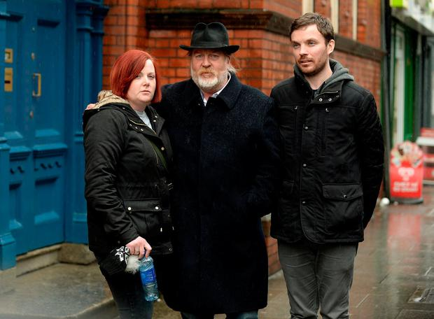 Family members of the late Donna Fox – sister Leanne, father Peter and brother Neil – outside the Coroner's Court after the inquest into the cyclist's death. Photo: Caroline Quinn