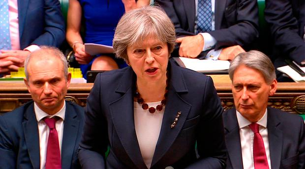 British Prime Minister Theresa May addresses the House of Commons yesterday. Photo: Reuters