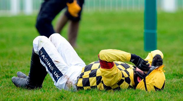 Ruby Walsh lies on the ground after falling off Al Boum Photo at Cheltenham