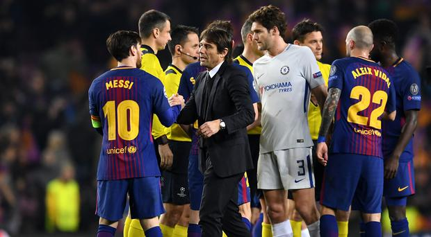 BARCELONA, SPAIN - MARCH 14: Lionel Messi of Barcelona and Antonio Conte, Manager of Chelsea shake hands after the UEFA Champions League Round of 16 Second Leg match FC Barcelona and Chelsea FC at Camp Nou on March 14, 2018 in Barcelona, Spain. (Photo by David Ramos/Getty Images)