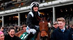 Jockey Katie Walsh celebrates after winning the Weatherbys Champion Bumper on Relegate. Photo: Ramsey Cardy/Sportsfile