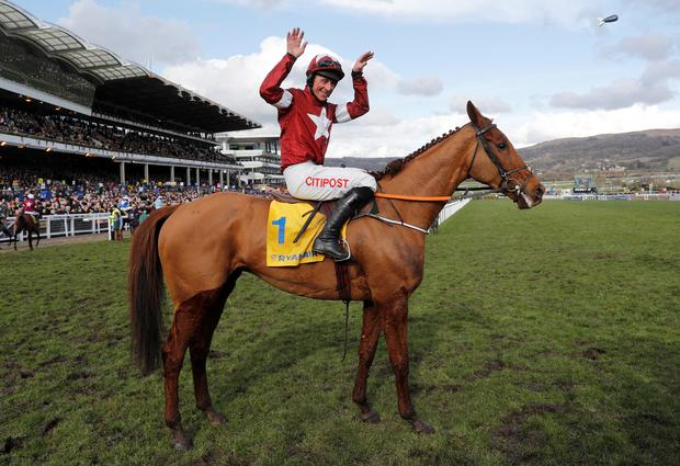Davy Russell celebrates on Balko Des Flos after winning the 14:50 Ryanair Chase REUTERS/Darren Staples