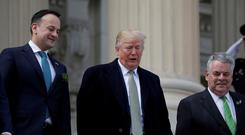 U.S. President Donald Trump, accompanied by Taoiseach Leo Varadkar (L) and Rep. Peter King (R-NY), (R), departs after attending a Friends of Ireland event at the U.S. Capitol in Washington, U.S., March 15, 2018. REUTERS/Aaron P. Bernstein