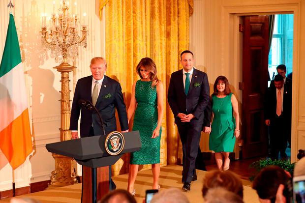 US President Donald Trump, his wife Melania and Taoiseach Leo Varadkar arrive at the annual shamrock presentation ceremony at the White House in Washington DC, USA. Picture: Niall Carson/PA Wire