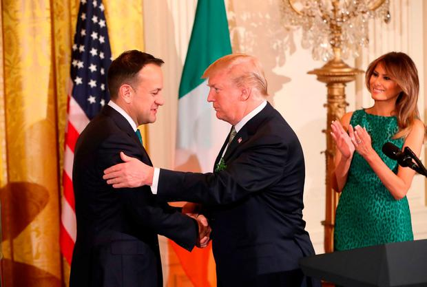 US President Donald Trump, his wife Melania and Taoiseach Leo Varadkar (left) attend the annual shamrock presentation ceremony at the White House in Washington DC, USA. Picture: Niall Carson/PA Wire