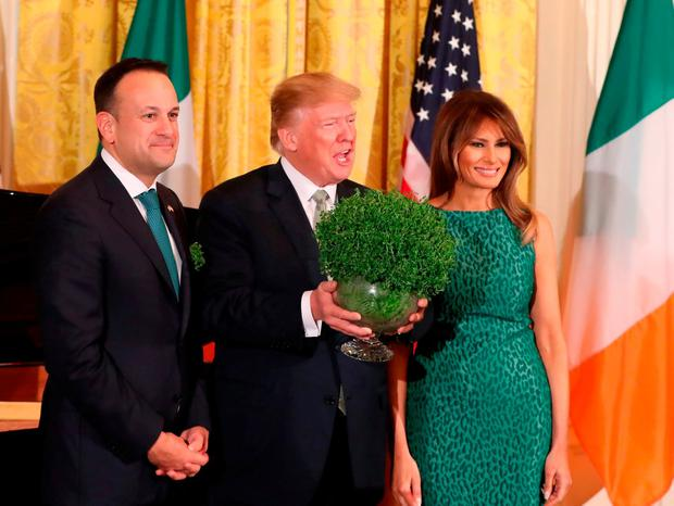 Taoiseach Leo Varadkar presents US President Donald Trump with a bowl of shamrock as Melania Trump looks on during the annual presentation ceremony at the White House in Washington DC, USA. Picture: Niall Carson/PA Wire