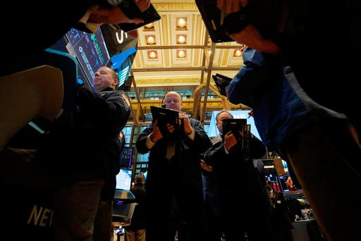 Traders work on the trading floor at the New York Stock Exchange (NYSE)