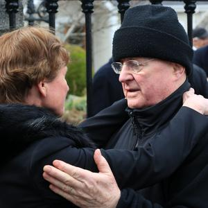 Christy Moore consoles Liam O'Flynn's wife Jane pictured at the funeral of uilleann piper, Liam O'Flynn this morning at St. Brigid's Church, Kill, Co. Kildare...Picture Colin Keegan, Collins Dublin.