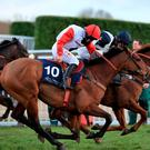 Pacha Du Polder ridden by jockey Harriet Tucker goes on to win the St. James's Place Foxhunter Challenge Cup Open Hunters' Chase during Gold Cup Day of the 2018 Cheltenham Festival at Cheltenham Racecourse.