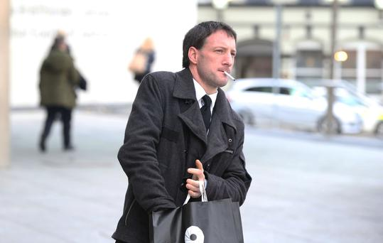 John Tighe (40) of Lavallyroe, Ballyhaunis, Co Mayo, pictured leaving Central Criminal Court in Dublin this evening where he is on trial for the murder of his six-and-a-half month old son, Joshua Sussbier Tighe, at his home on June 1, 2013 Picture: Collins Courts