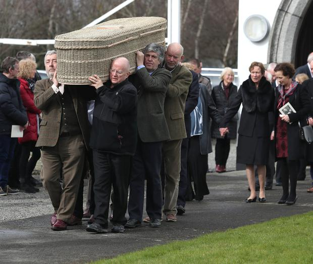 From right to left are, Neil Martin, Christy Moore, and Paddy Glackin carrying the coffin as Jane OFlynn and her friend Deirdre Bowler follow at the funeral of Liam O'Flynn at St Brigids Church in Kill, Co. Kildare. Picture credit; Damien Eagers