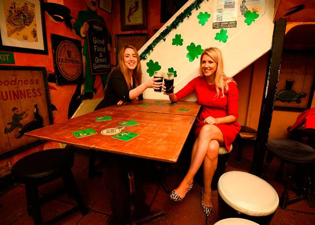 Martha Farrell and Sandra Truesdale in the Toucan pub in Soho, in London ahead of tomorrow's Six Nations match against England at Twickenham Kirsty O'Connor/PA Wire