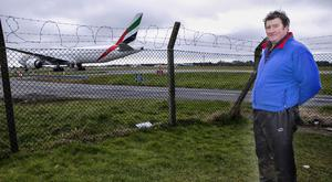 Dairy Farmer Jim Scully pictured beside Dublin Airport near to where his farm is.